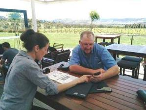 Sense-Co's Libby Graham shows the app to Viticulture Manager Danny Belbin from Frogmore Creek Winery